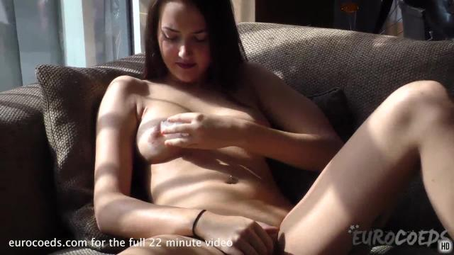 Patricia sun back and masturbating on my couch with a nice blue dildo